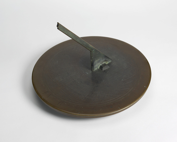 A circular coppered metal sundial signed by famed London clockmaker Thomas Tompion (bap. 1639, d. 1713). The dial hasaplain central metal pointer (gnomon). The outer ring of dial has a moulded outer edge and is incribedwith Roman numeral