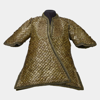 Coat of scale armour with short wide sleeves, of padded green velvet fortified overall with horny scales; each scale with a gold-edged floral design, and a jewelled border with smaller scales encrusted with rubies and turquoises in gold settings.