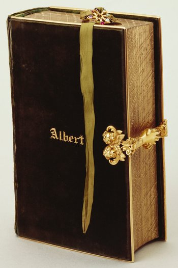 Green velvet binding with Prince Albert's name tooled in gold on the front board.<br> <br>The German inscription on the inside cover of this prayer book states that it was given to Prince Albert to commemorate his wedding day by his ever-loving aunt, Vict