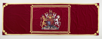 Rectangular velvet hanging, bearing the coat of arms of the United Kingdom. Taken from MV Spirit of Chartwell when used as the Royal Barge.
