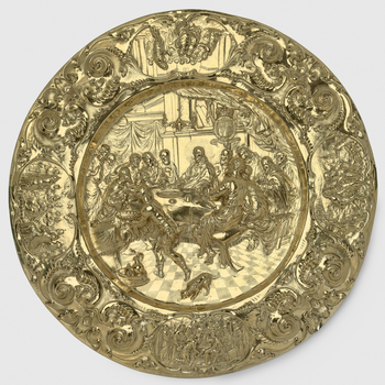 Silver gilt alms dish, sunken centre embossed with The Last Supper and the royal Stuart arms (1603-89). Broad rim with auricular scrollwork and oval reserves containing scenes of 'The Washing of the Apostles' Feet', 'The Road to Emmaus', 'Christ's Commiss
