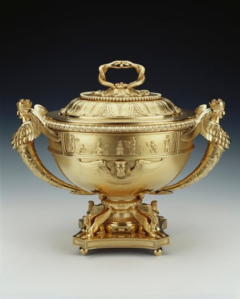 A set of four silver-gilt tureens with covers, liners and stands. The tureen has two term handles cast as Diana of Ephesus (a many-breasted goddess of fertility with a crown), and a frieze of relief scenes of figures sacrificing and winged Egyptian masks,