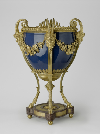 A Chinese porcelain cistern with French gilt-bronze mounts. A large, tub-shaped vessel, with sides curving below and rising to an indented band below the open mouth. The exterior is covered with a rich blue glaze, incidental splashes of which dot the whit