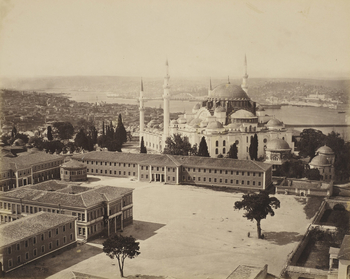 View of the Suleymaniye Mosque and complex, in Constantinople, Turkey. The campus of Istanbul University is in the foreground.  This is the first section of a panoramic (but not exact) view from the top of the Seraskier tower. The photograph is signed a