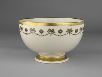 Commemorative bowl: creamware with gilded decoration including the US eagle. Fitted blue box with pale green silk lining. The Lenox China Company was founded by Walter Scott Lenox (1859-1920) in 1889. The firm took its current name in 1906 and from that d
