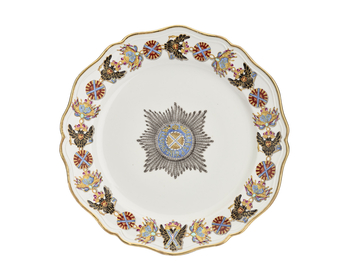 A Russian, Gardner factory porcelain dessert plate w a shaped gilt rim & moulded, shaped-line border, the border painted w the collar of the Order of St. Andrew, the Star of the order at the centre.
