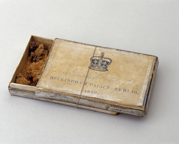 A cardboard box containing a piece of Queen Victoria's wedding cake.
