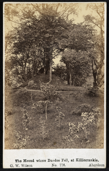 Photograph of the mound where the Jacobite John Graham of Claverhousewas killed during the Battle of Killiecrankie in July 1689. A tree grows at the top of the mound and smaller saplings are planted on the lower slopes. <br /><br />John Graham, the