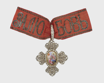 Cross set w brilliants; centre O/: St Catherine w wheel & diamond-set cross, various initials; R/: 2 eagles feeding young in nest on mountain-top beneath motto. On diamond-set s/loop. Bow rose silk, silver thread at edges, motto in sequins