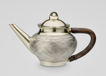 A Russian silver and  parcel gilt teapot with detachable cover. The pot with an angular brown leather covered handle and a straight spout. The body cast and chased with a woven reed pattern.   Lid struck with city mark of St