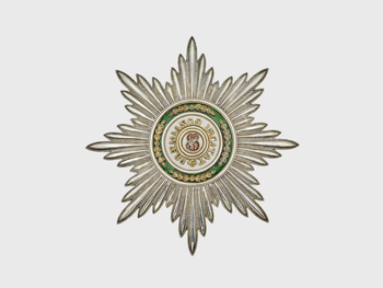 Order of St Stanislaus, star silver smooth-rayed star w the Saint's monogram in red enamel and the Order's motto PRAEMIANDO INCITAT ('Encouraged by reward'). Surrounded by 4 sets of oak leaves in gold. Rev. gilt.