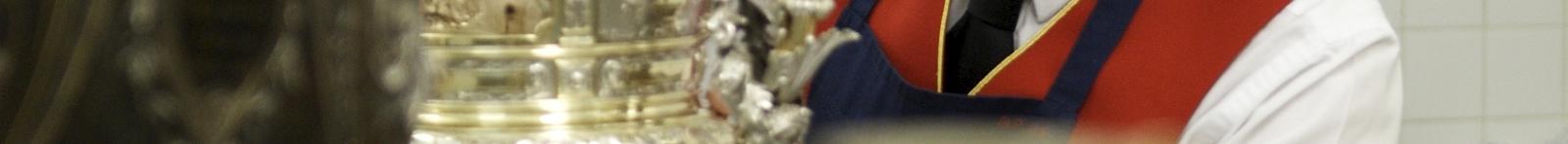 A footman polishing silver at Buckingham Palace
