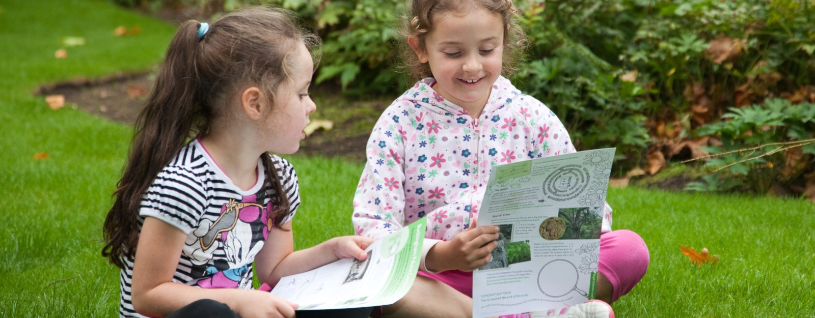 children looking at an activity trail in Buckingham Palace Garden