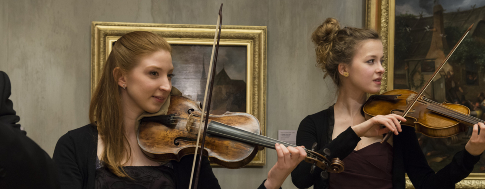 Photograph of two women playing the violin