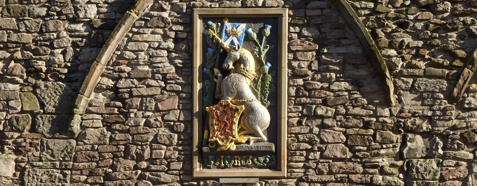 Painted unicorn on a building at the Palace of Holyroodhouse