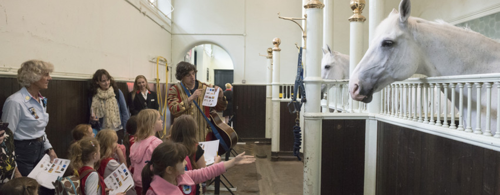 Children and a horse at the Royal Mews