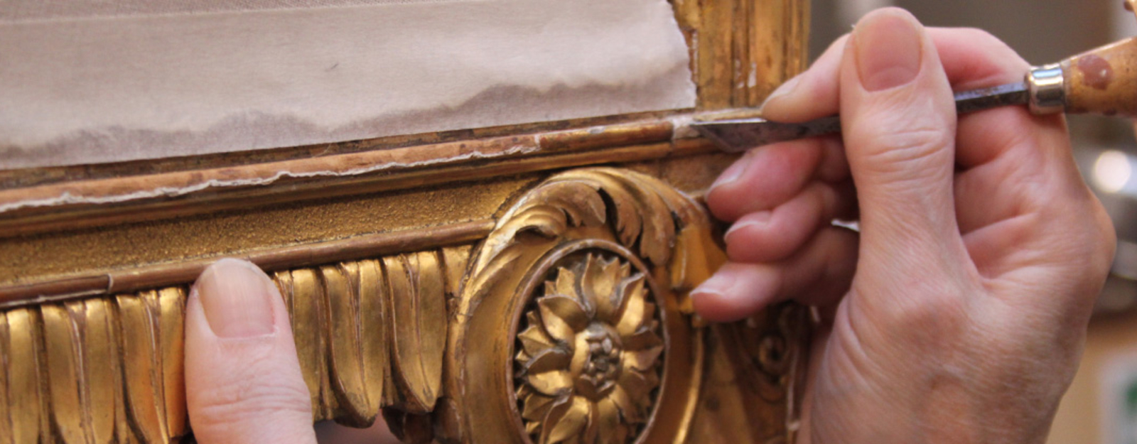 Chair being worked on in the gilding studio