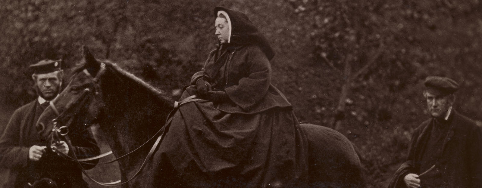 Queen Victoria on top of a horse next to her steward