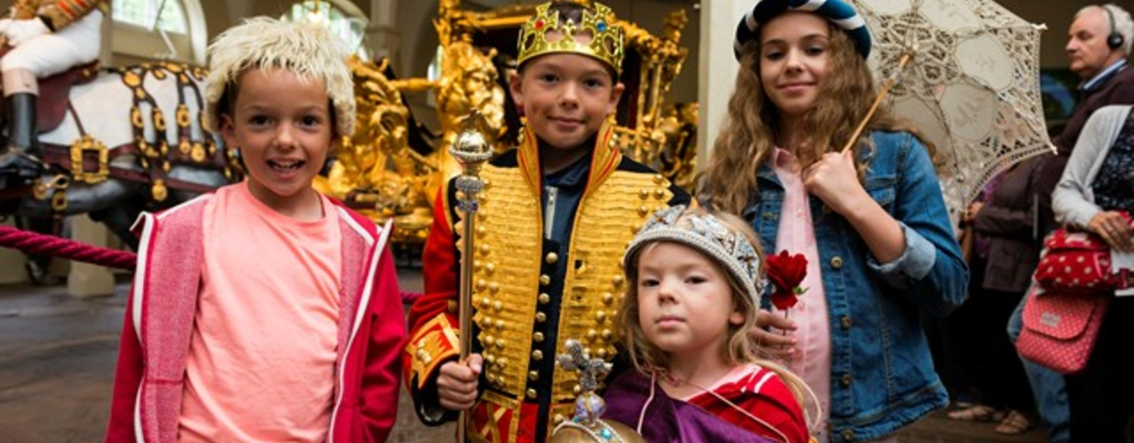 Children try on costumes at The Royal Mews, Buckingham Palace