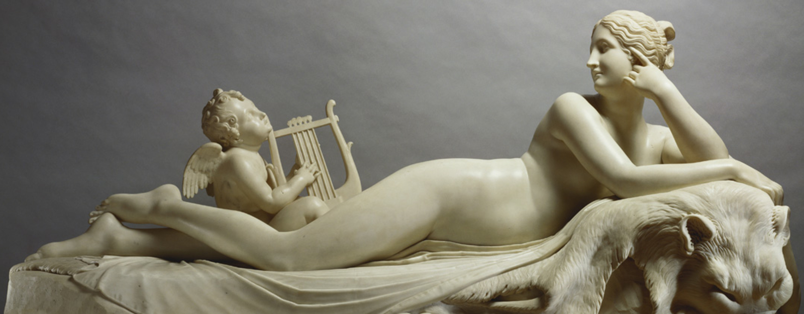 Nymph reclining with a nymph playing a lyre