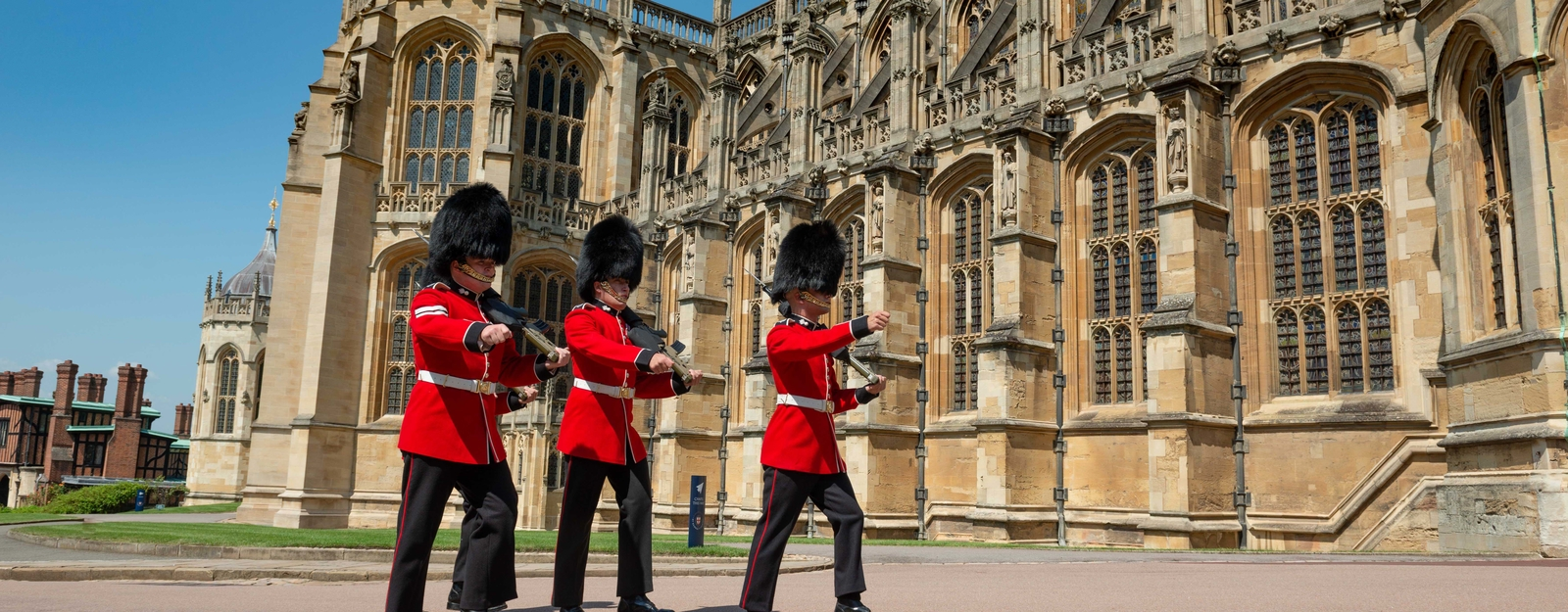 Soldiers walk past St George's Chapel