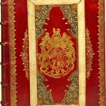 Contemporary binding of red goatskin by the Royal Heads Binder for Charles II with his arms on front and back covers, the covers elaborately tooled in gilt, borders with double roll-tool border with acorn tools and with volute corner tools, the central pa