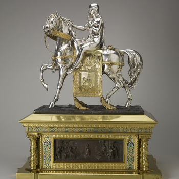 This figure of Lady Godiva was purchased by Queen Victoria and presented to Prince Albert on his birthday, 26 August 1857.  It was modelled by the French sculptor Pierre-Emile Jeannest, who worked for both Minton and Elkington. At the Great Exhibition h