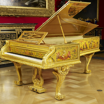Grand piano with gilded and painted surface by François Rochard in polychrome colours with singeries and Berainesque motifs. Mouldings and rim of piano of bronze, chased and gilt. Supported on three incurving cabriole legs of gilded wood with heavy
