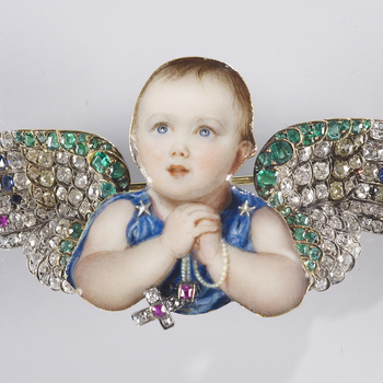 Mounted in gold, the cut out enamel miniature of the Princess Royal clasping a string of pearls from which hangs a real diamond and ruby crucifix. She has bejewelled wings mounted at the shoulders. <br>  <br>Queen Victoria's first child, also named Victor