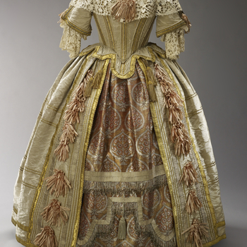 The most glamorous of all Queen Victoria's surviving clothes, this costume was inspired by the court of Charles II. The rich brocade of the underskirt was woven in Benares. The lace of the berthe is a copy of seventeenth-century Venetian raised-poin