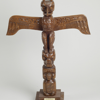 <p>A Canadian Northwest-Coast First Nations wooden totem pole carved with a thunderbird, wings outstretched, a beaver and a human figure at the base, on a double-stepped base.<br /><br />Thunderbirds feature prominently in Northwest-Coast indige