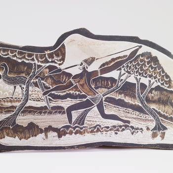 This slate plaque, in the stylised shape of the continent of Australia, depicts a hunting scene. It was presented to Queen Elizabeth II by Albert Barunga and his wife(c. 1910-1977) on the occasion of her Silver Jubilee in 1977.A Presbyterian m