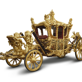 The gilded eight horse-drawn State Coach. Designed by William Chambers (1723-96) and made by the coachmaker Samuel Butler; featuring painted panels by Giovanni Cipriani (1727-85) and richly gilded carved sculpture by the carver Joseph Wilton (1722-1803),