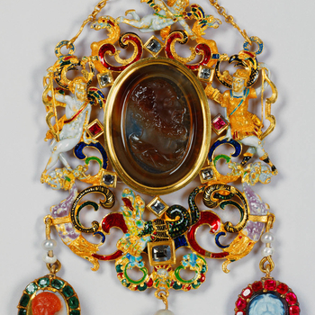 Obverse: a sard cameo representing a bearded male head, in profile to the right; with surrounding open scrollwork frame set with seven table-cut diamonds and two rubies and incorporating: to the left, a reclining figure of Cupid; to the right, Apollo with