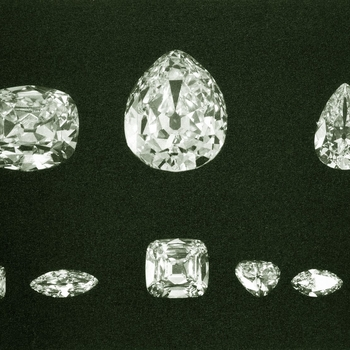 Photograph of the nine complete diamonds cleft from the Cullinan Diamond. Cullinan I and II, the two largest cut diamonds, were reserved for King Edward and in 1909 they were temporarily mounted as a somewhat oversized pendant brooch. After Edward VII's