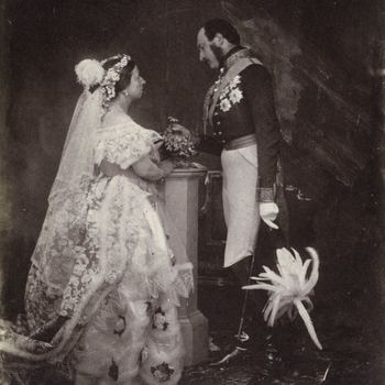 Photograph showing a full length portrait of Queen Victoria (1819-1901) and Prince Albert (1819-61), photographed at Buckingham Palace. Queen Victoria stands in right side profile and wears formal court dress. Prince Albert stands in left side profile, ho