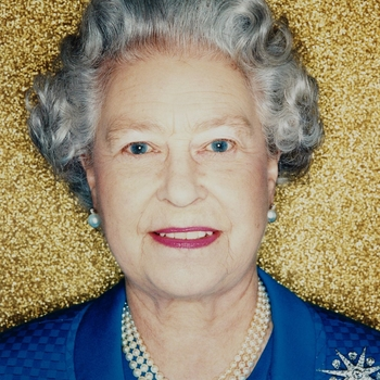 Photograph of HM The Queen (b. 1926) taken at Buckingham Palace.  This is one of a portfolio of photographs commissioned to mark the fiftieth anniversary of her Accession in 2002.  The Queen is photographed against a gold background and wears a 3-row pear