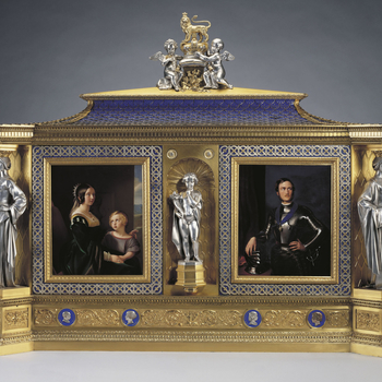 This jewel cabinet is a proud dynastic statement incorporating the Queen's favourite image of the Prince, the Royal and Saxe-Coburg arms, and portraits of their six children born before 1851. Designed in the form of a large reliquary, the cabinet wa