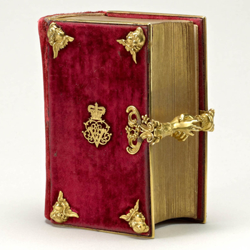 This Book of Common Prayer was given to Victoria on her wedding day by her mother the Duchess of Kent, and was the companion volume to the green velvet prayerbook bestowed upon Prince Albert by his future mother-in-law. The binding was decorated with Vict