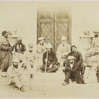 Photograph showing a group of eleven men including the Prince of Wales, later King Edward VII, seated and standing around a low set of steps. The photograph was taken in Cairo in March 1862 during the tour of the East made by the Prince of Wales. The Prin