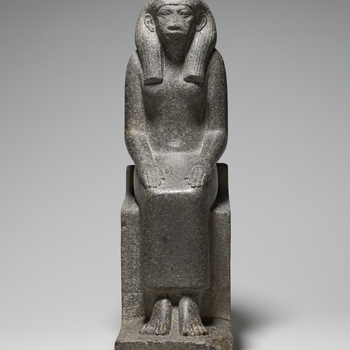Black granite statue of Queen Senet, consort and mother of two as yet unidentified pharaohs of the XII Dynasty (c.1985–1785 BC). She is depicted seated on a throne with her hands resting on her thighs, palms down, fingers outstretched, and wearing a str