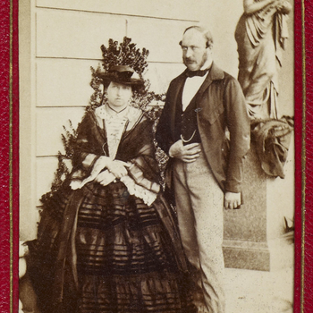 Carte-de-visite of Queen Victoria (1819-1901) and Prince Albert, Prince Consort (1819-1861) at Osborne in the 1850s. The photograph shows the Queen and Prince Albert standing together in front of a statue of a woman, with the Queen on the left.Queen