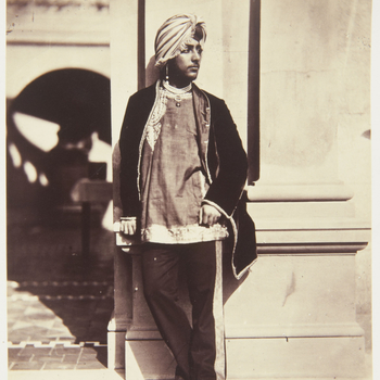 Photograph of Dalip Singh wearing a turban and standing, facing three-quarters right against a wall on the terrace at Osborne.  Following the annexation of the Punjab by the British East India Company, Maharajah Dalip Singh was initially given a pension