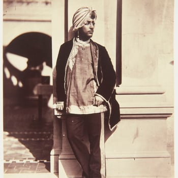 Photograph of Dalip Singh wearing a turban and standing, facing three-quarters right against a wall on the terrace at Osborne.