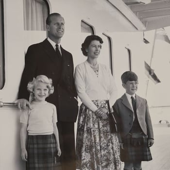 The Royal Family stood on the deck of the Royal yacht