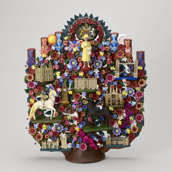 A Tree of Life featuring Queen Elizabeth II modelled from clay and decorated with colourful symbols representing British culture and the interests of Her Majesty. In a red leather presentation box with a gold embossed symbol of Mexico and 'MEXICO / PRESID