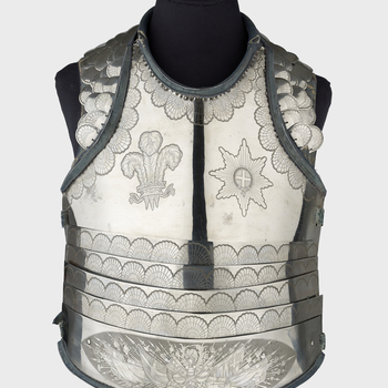 Parade breastplate consisting of a large plate of burnished iron covering the upper part of the breast, cut with neck and the arm-openings and overlapped at its lower edge by five upward-overlapping transverse lames of which the lowest lame is deeper than