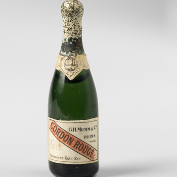 Miniature green glass bottle of vintage champagne (Mumm)