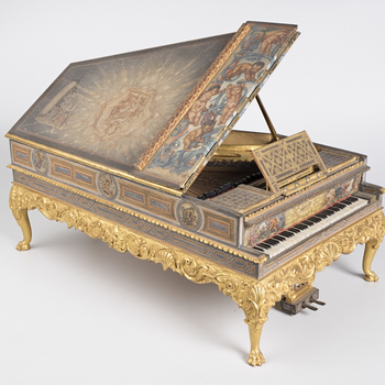Miniature concert grand piano in the 'Vernis Martin style'; the angular case painted with various scenes including a maiden offering flowers to Apollo on the lid; putti with musical staves on roundels on sides; the interior of the lid with an image of 'Th