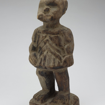 Modern copy of a Bieri (reliquary guardian). The original Bieris would have stood in a family home of the Fang people, to remember a deceased ancestor. Traditional reliquary guardians protect and mark the location of ancestor's remains.  Statue of a s